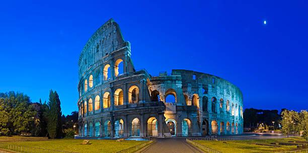 Rome Coliseum by moonlight ancient Roman amphitheater night panorama Italy stock photo