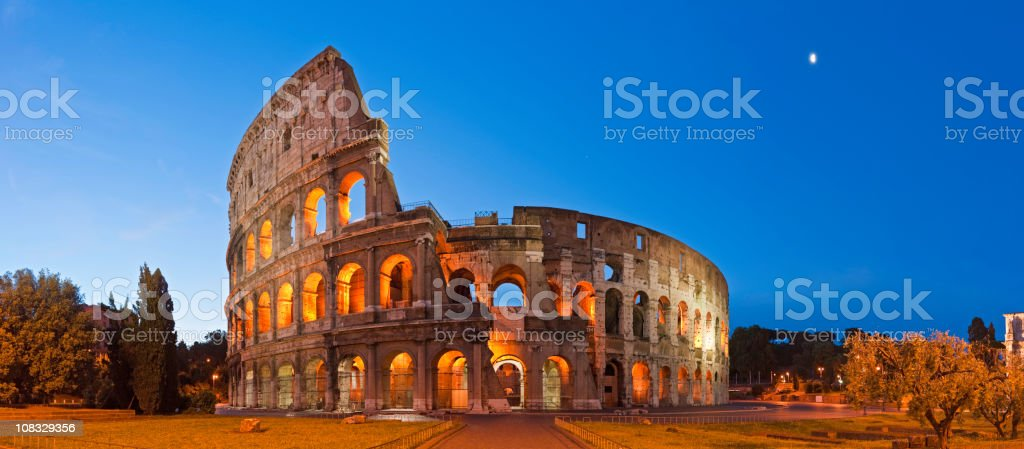 Rome Coliseum Colosseo ancient roman amphitheatre Italy panorama blue moon stock photo