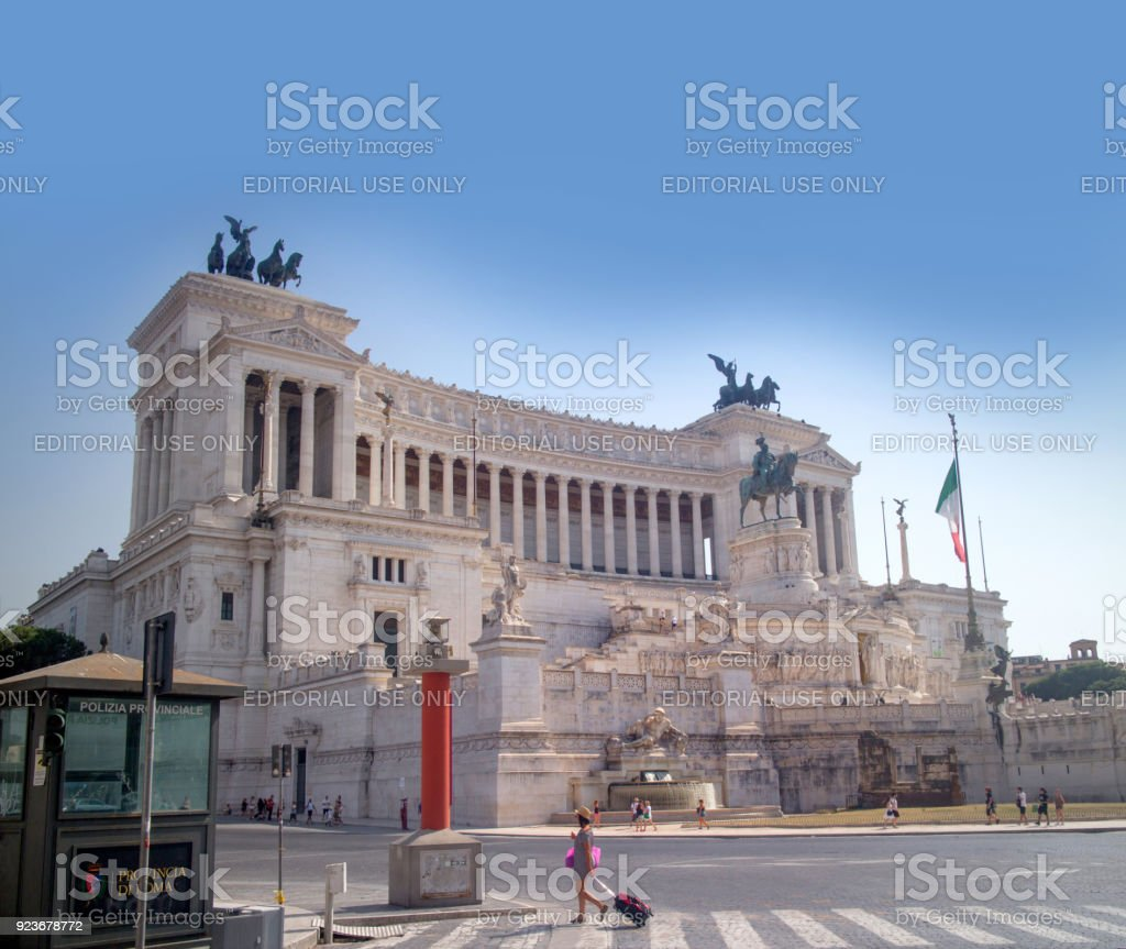 Rome, Italy - August 5th 2017: Tourists walking past The Altare della Patria (in english: 'Altar of the Fatherland'), also known as the Monumento Nazionale a Vittorio Emanuele II stock photo