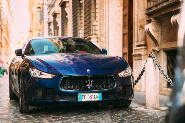 Rome, Italy. Blue Color Maserati Ghibli M157 Car Parked At Street stock photo