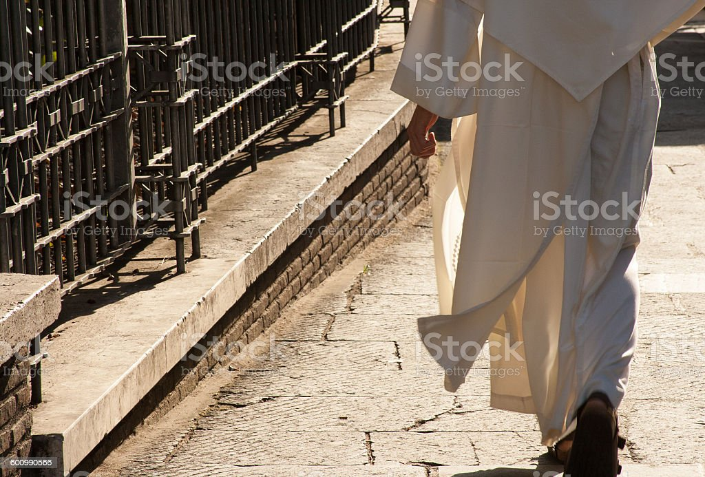 Rome, Italy: Catholic Cleric in White Robe (Close-Up) stock photo
