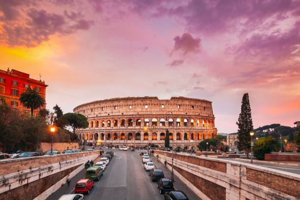 Rome, Italy. Colorful Sunset Sky Above Colosseum Also Known As Flavian Amphitheatre In Evening Time. stock photo