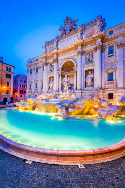 Rome, Italy - Fontana di Trevi Rome, Italy. Stunningly ornate Trevi Fountain illuminated at night in the heart of baroque Roma. rome italy stock pictures, royalty-free photos & images