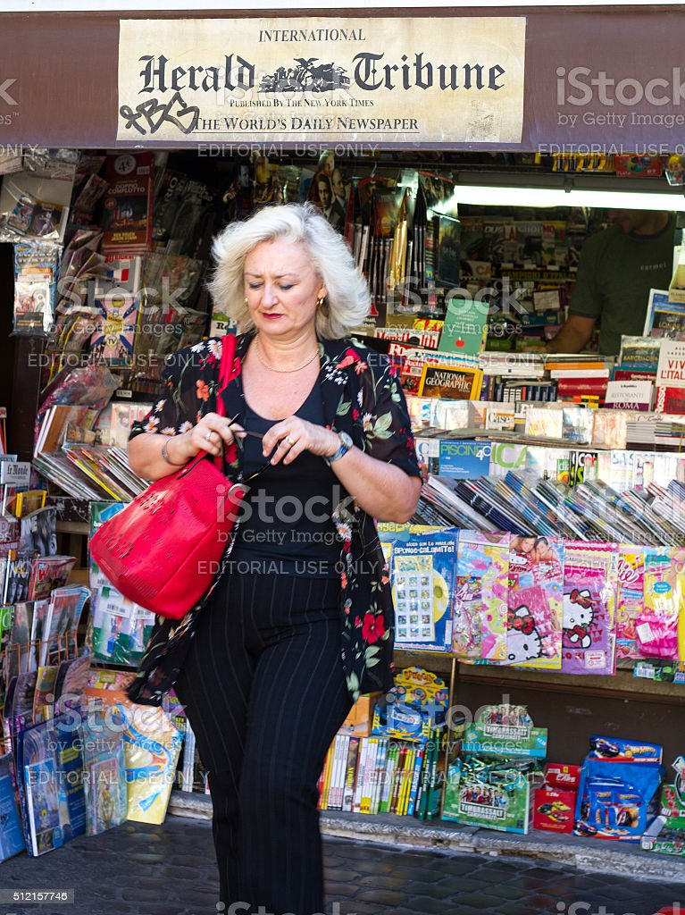 Rome, Italy: Newsstand Selling International Herald Tribune and Customer stock photo