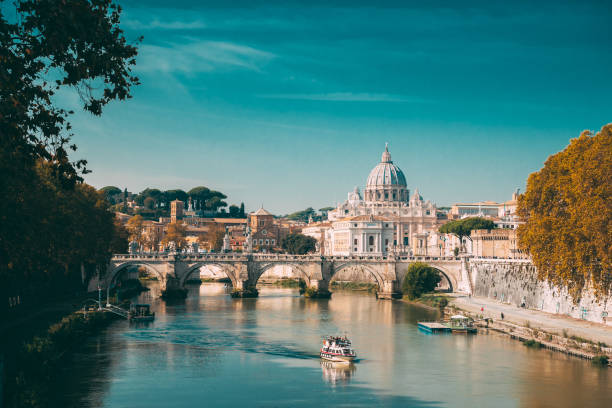 Rome, Italy. Papal Basilica Of St. Peter In The Vatican. Sightseeing Boat Floating Near Aelian Bridge. Touristic Boat stock photo