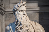 Rome, Italy, May 2018: Detail of the Marble statue of Moses sculpted by Michelangelo located in San Pietro in Vincoli church.