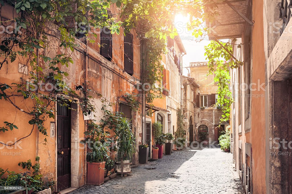 Rome, Italy A picturesque street in the historic Trastevere district, Rome, Italy Alley Stock Photo