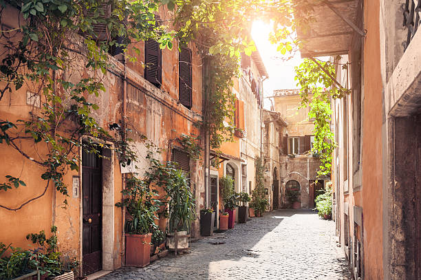 Rome, Italy A picturesque street in the historic Trastevere district, Rome, Italy alley stock pictures, royalty-free photos & images