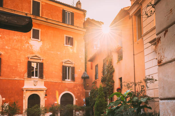 Rome, Italy. Sunshine Sun Shine Above Roofs Old Houses stock photo
