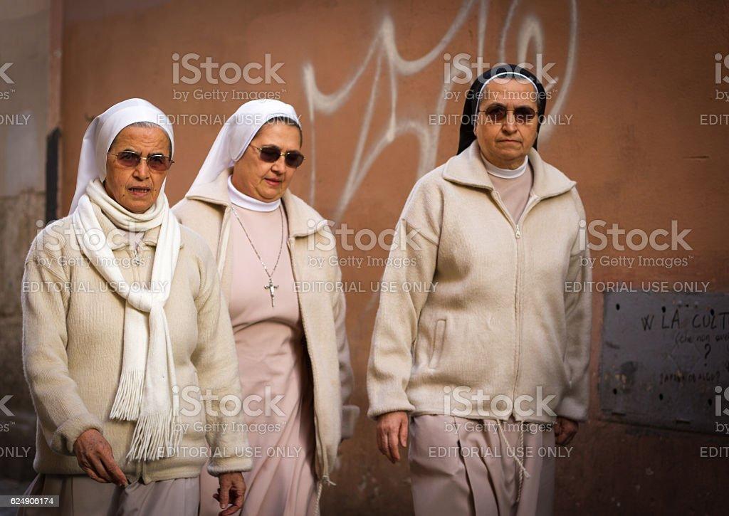 Rome, Italy: Three Nuns in Sunglasses Walk in Trastevere (Close-Up) stock photo