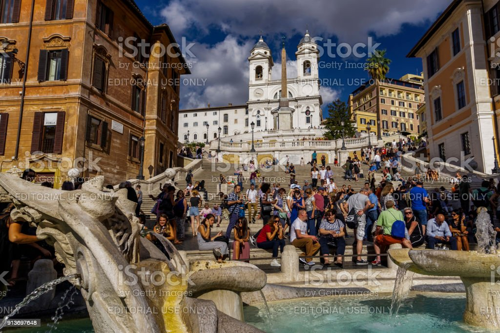 Rome Italy Trinita dei Monti church next to the Spanish Steps with crowd. stock photo