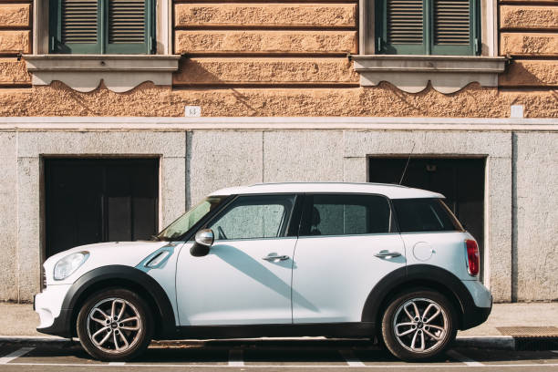 Rome, Italy. White Color Car Mini Cooper Mini Countryman Parked On Street stock photo
