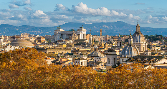 Rome skyline during autumn season, as seen from Castel Sant'Angelo, with the dome of Saint Agnese Church, the Campidoglio and the Altare della Patria monument.