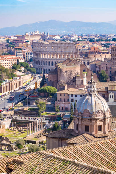 Rome skyline with the Colosseum visible in the back stock photo