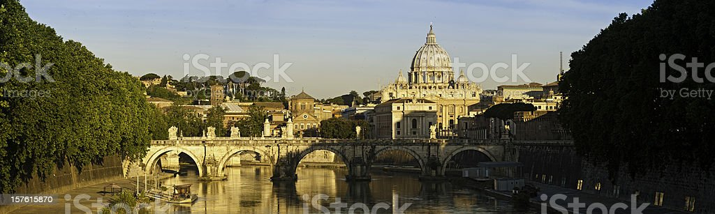 Rome sunrise Ponte Sant'Angelo Vatican St Peter's Tiber panorama Italy stock photo
