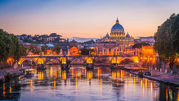rome sunset over tiber and st peters basilica vatican italy - italy stock photos and pictures