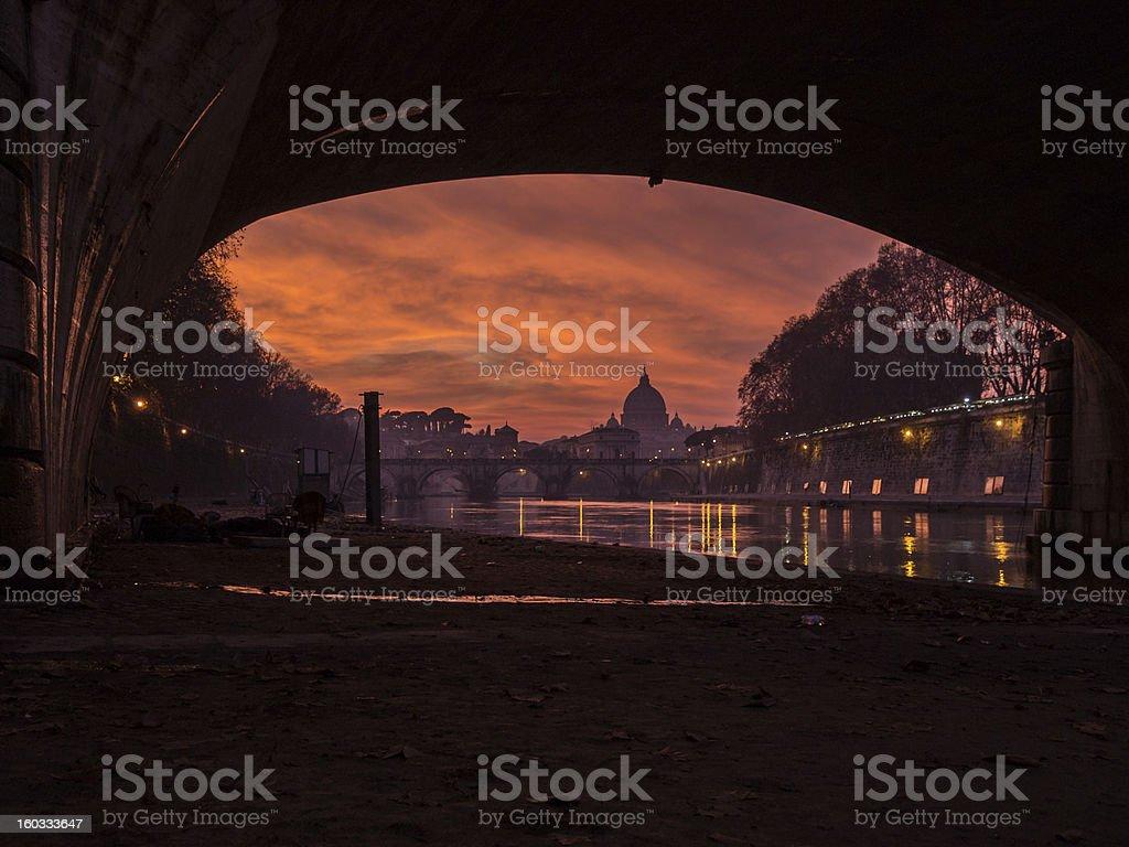 Rome sunset under the bridge stock photo