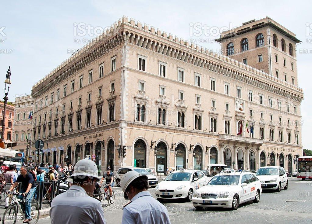 Rome traffic Policemen with Palazzo delle Assicurazioni stock photo