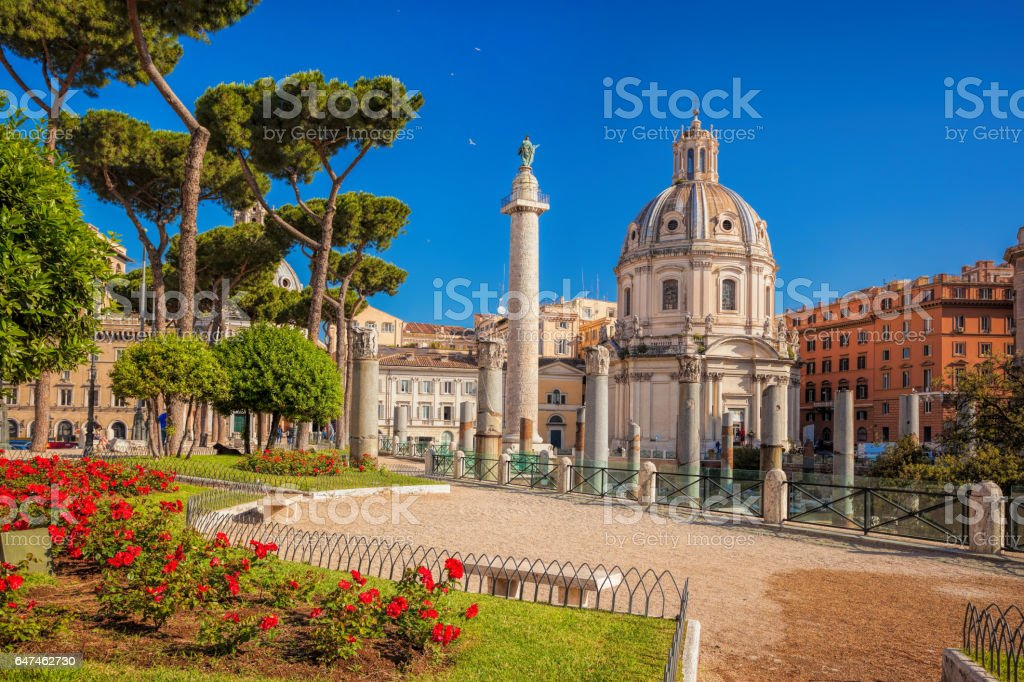 Rome with Santa Maria di Loreto church against Trajan column in Italy stock photo