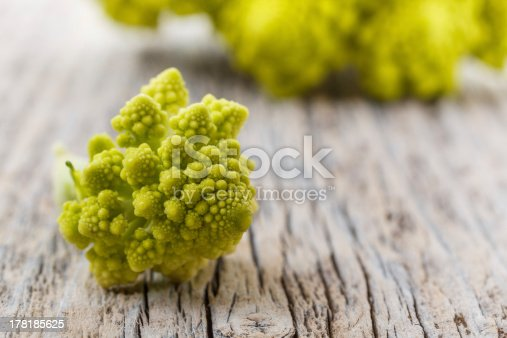 Fresh green romenasco broccoli on rustic wooden table