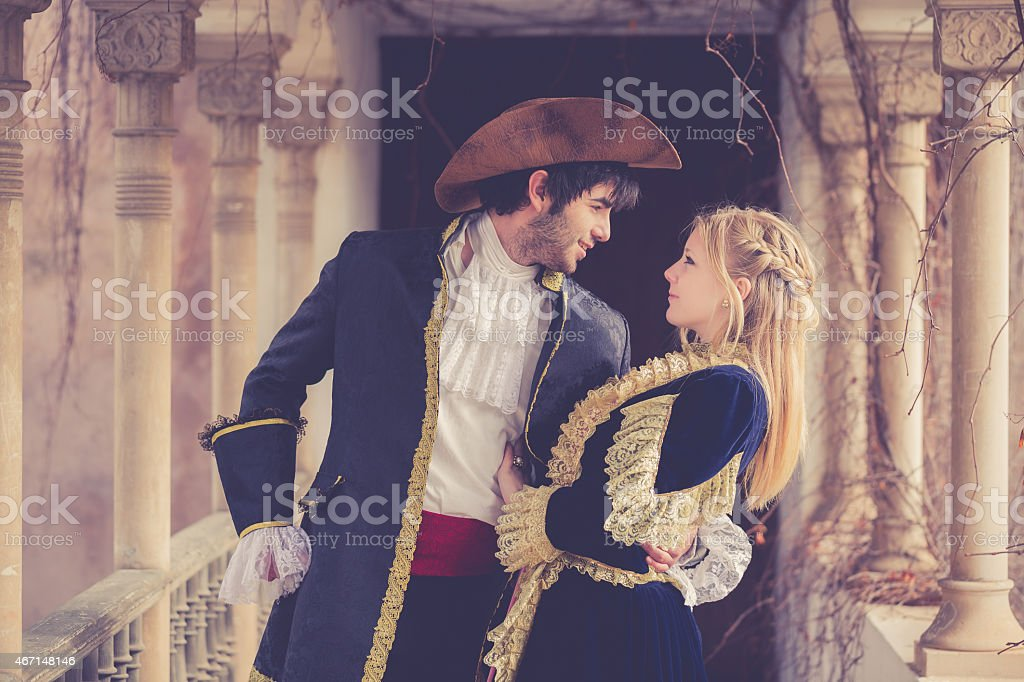 romeo and juliet embracing at balcony stock photo