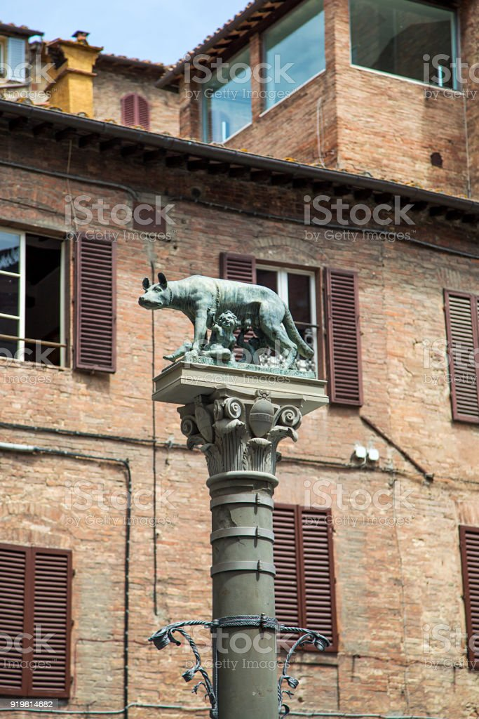 Romulus and Remus statue at Piazza Tolomei in Siena stock photo