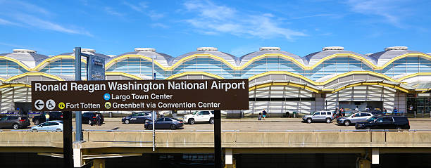 Ronald Reagan Washington National Airport Alexandria, Virginia, United States - August 13, 2015: Terminal C of Ronald Reagan Washington National Airport. Some people and cars are visible in front of the building. ronald reagan washington national airport stock pictures, royalty-free photos & images