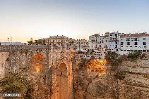 Puente Nuevo bridge with El Tajo Gorge in Ronda in sunset, spanish province of Malaga, Spain