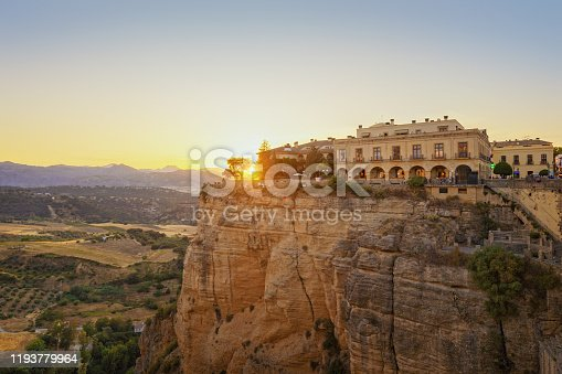 Beautiful sunset with tourist on the viewing platform in Ronda, province of Malaga, Spain