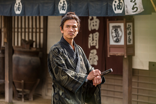Ronin Samurai Warrior With Katana In A Traditional Japanese Village