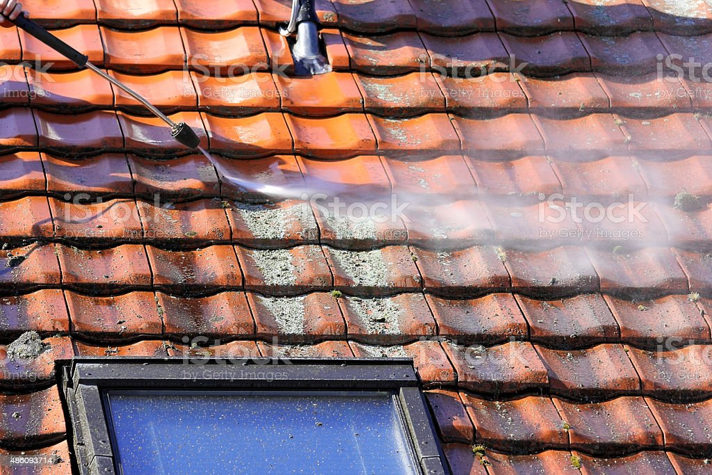 Roof cleaning with high pressure stock photo