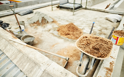 Shot of construction material with tools at a site