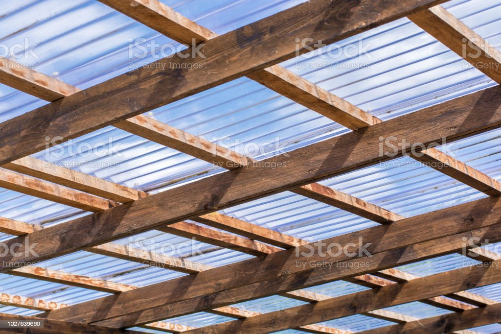 Roof Construction Of A Selfmade Carport Made Of Wooden Beams