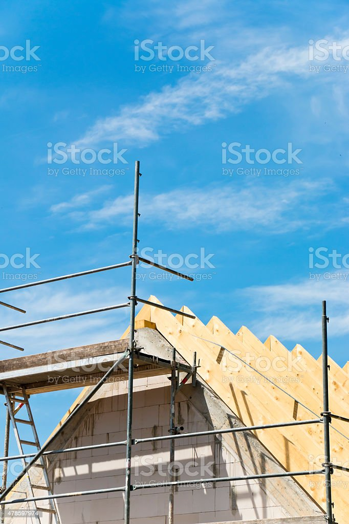 Roof construction with scaffolding of a new home stock photo