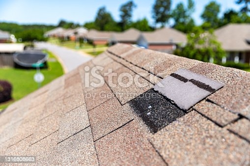 istock Roof damage after storm. 1316808663