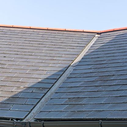 View of a roof showing the lead valley and roof slates.