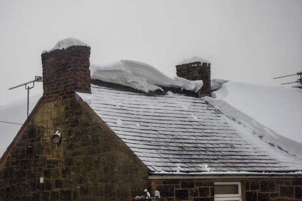 Roof exposed after snow slid off circa 1800 building. stock photo