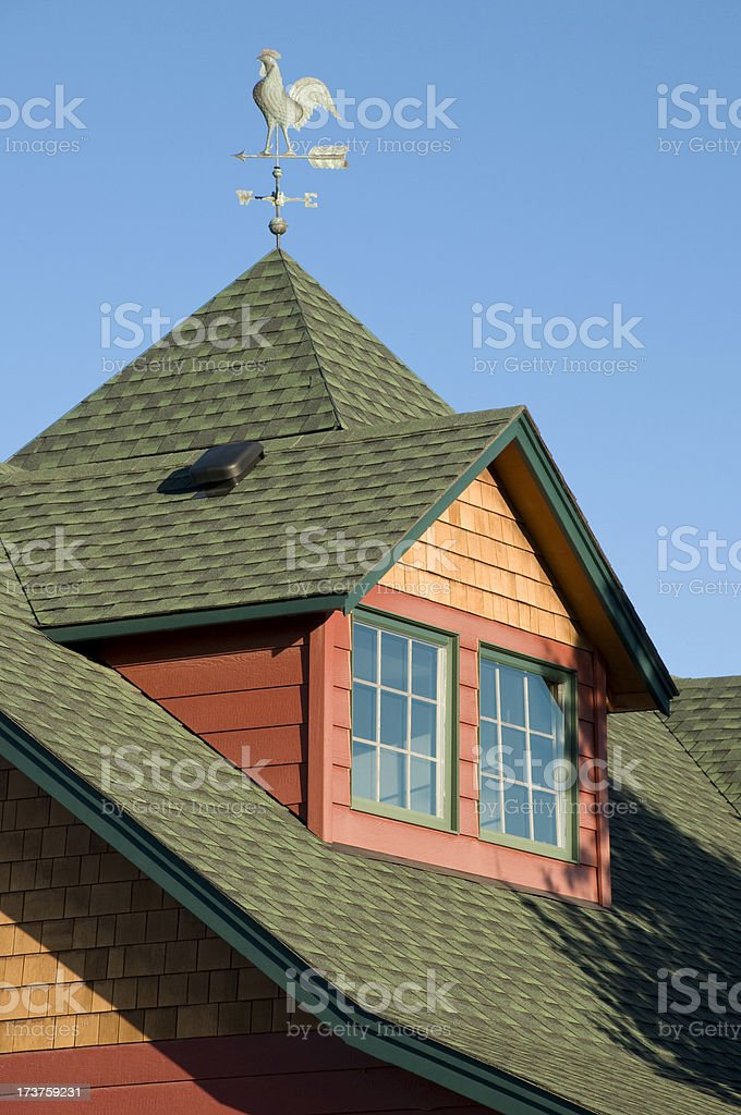 Roof gable and rooster weather vain stock photo