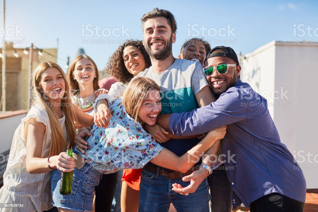 Roof garden party in Barcelona, young people celebrating. stock photo