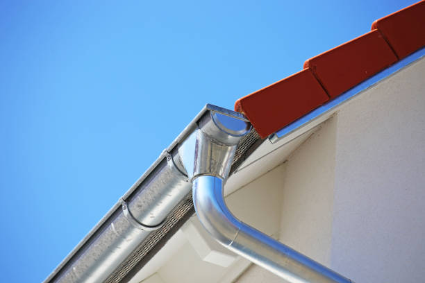 Roof gutter on a new tiled roof stock photo