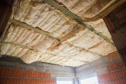 Roof Insulation Using Glass Wool Inserted Between The Rafters Stock Photo Download Image Now Istock