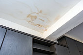 istock Roof leakage, water dameged ceiling roof and stain on ceiling 1165591837
