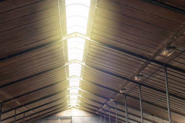 Roof light in old cattle shed. stock photo
