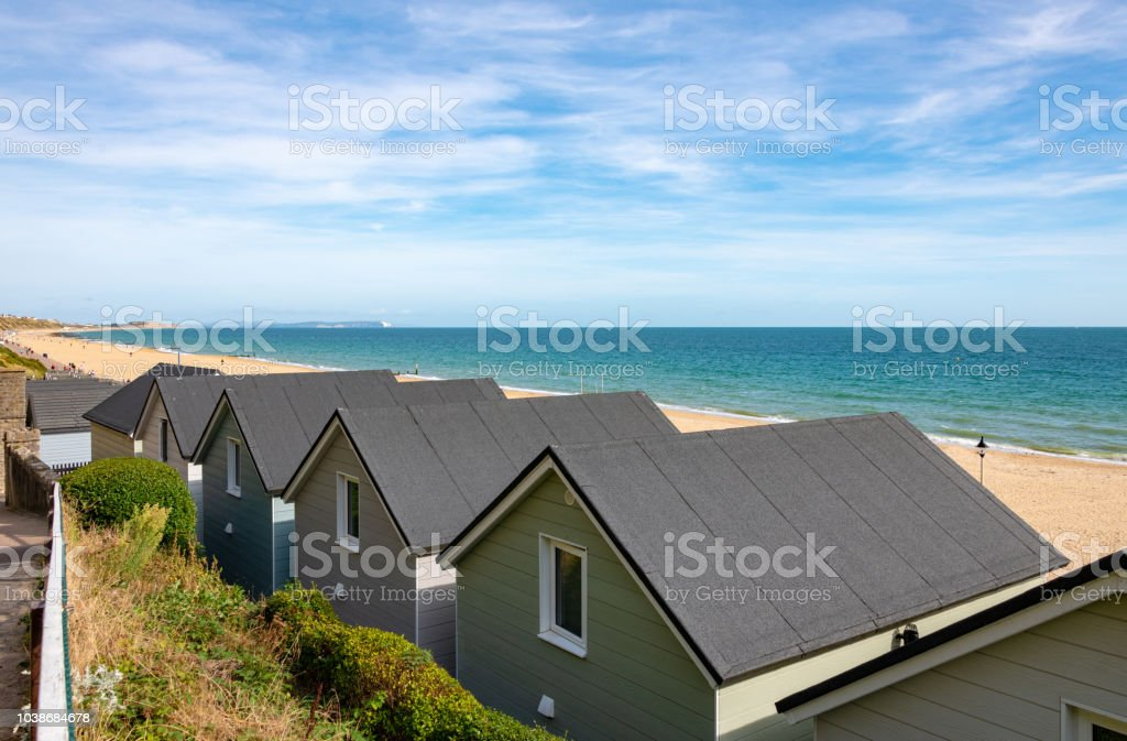 Roof line of beach huts by the beach stock photo