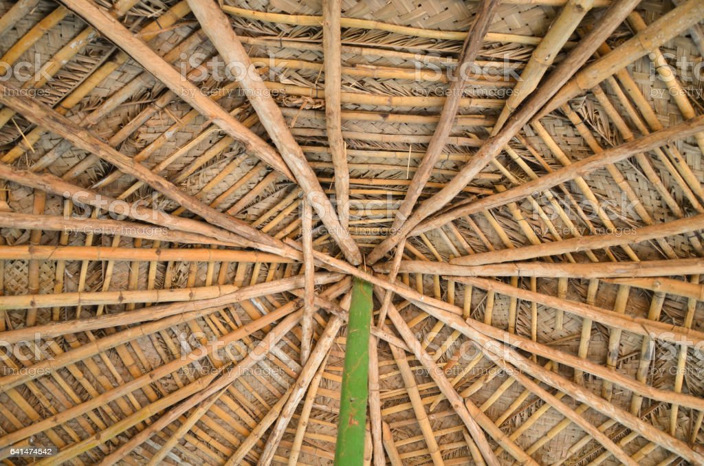 Roof of a hut made of bamboo and woven coconut leaves stock photo