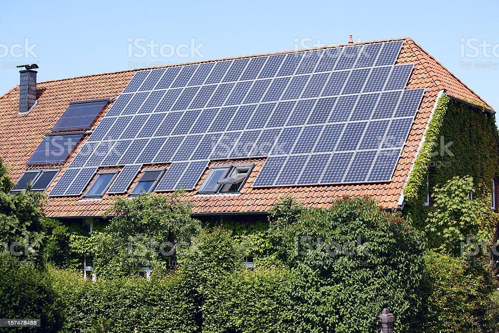 Roof of farmhouse with solar panels (XXXL) royalty-free stock photo