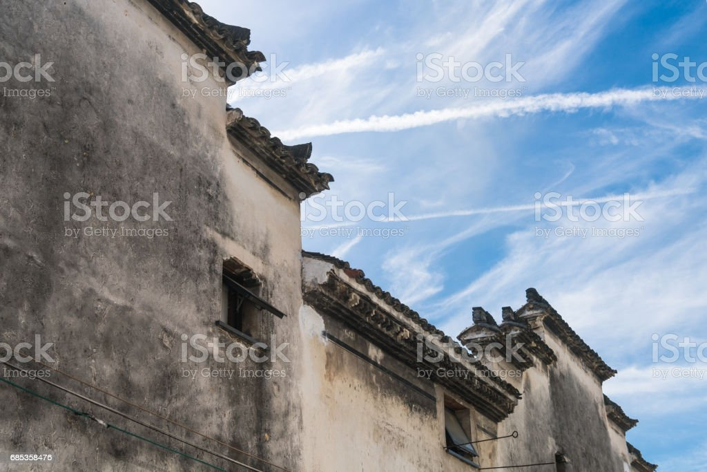 roof of historic building against blue sky royalty-free stock photo