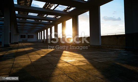 Roof of modern building at sunset.