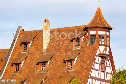 Roof of old half-timebred building in area around Kaiserbug castle in Nuremberg.