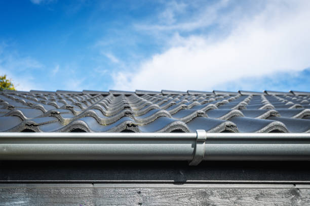 Roof on a house with tiles and a gutter stock photo